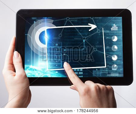 Business Technology Internet and network concept. Young businessgirl working on the tablet select on the virtual display