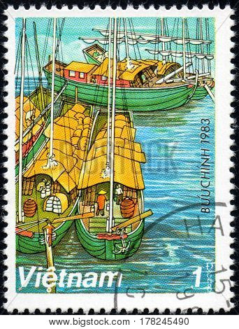 UKRAINE - CIRCA 2017: A postage stamp printed in Vietnam shows old sailing ships Sampans on Red River series Boats circa 1983