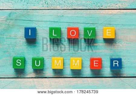 I Love Summer Written In Colorful Wooden Blocks On A Wooden Background With A Starfish
