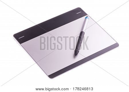 Graphic tablet with pen isolated on white background. For illustrators photographer and designers