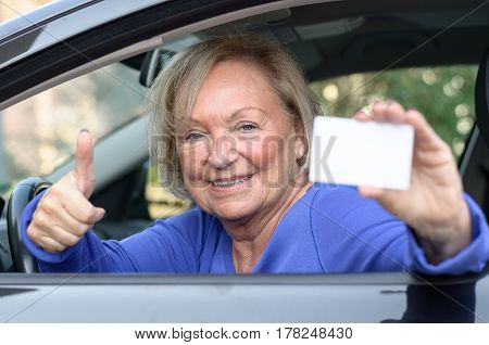 Elderly Woman Leaning From A Car Showing Her Licence