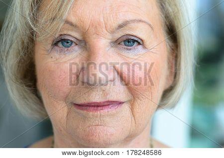 Senior Woman With Fair Hair And Blue Eyes