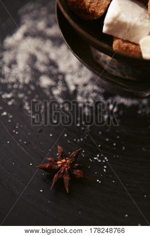 charming minimalistic still life with brown sugar, star anise, white sugar and vanilla pods