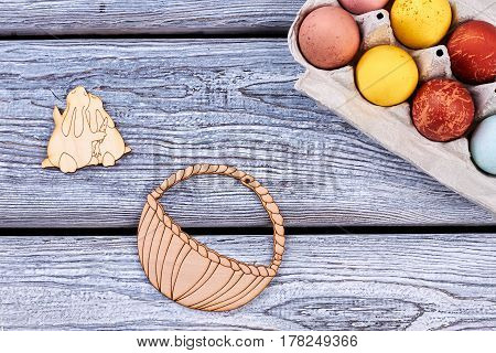 Painted eggs on wooden surface. Easter plywood figurines. Festive Easter mood.