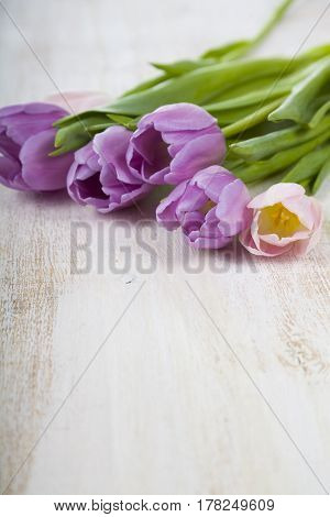 Bouquet Of Tulips On A Wooden Background.
