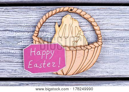 Plywood bunnies and basket. Easter congratulatory card. Wishes for Easter holiday.