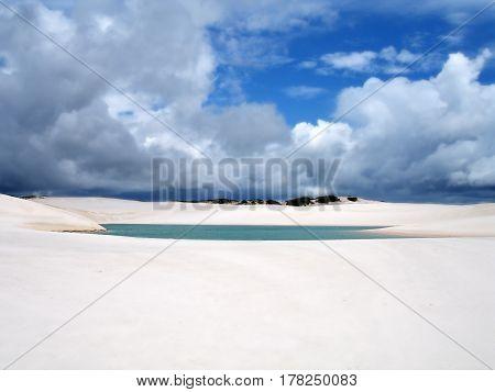 Lencois Maranhenses turquoise water color lagoon cloudy sky