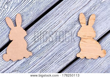 Plywood Easter rabbits. Cutout figurines of bunnies. Animalistic decorative items.