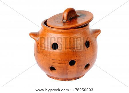 Clay pot for garlic storage on a white background