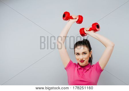 Fitness girl fit woman with dumbbells, doing exercise with dumb bells training with weights isolated on white background.