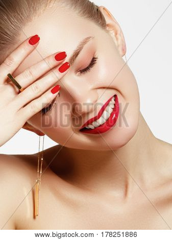 Makeup Products. Young Beautiful Girl With Gold Earrings And Ring Smiling On White Background. Red N