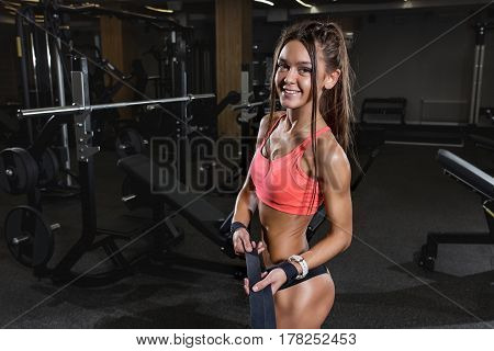 Athletic beauty  young woman posing in gym