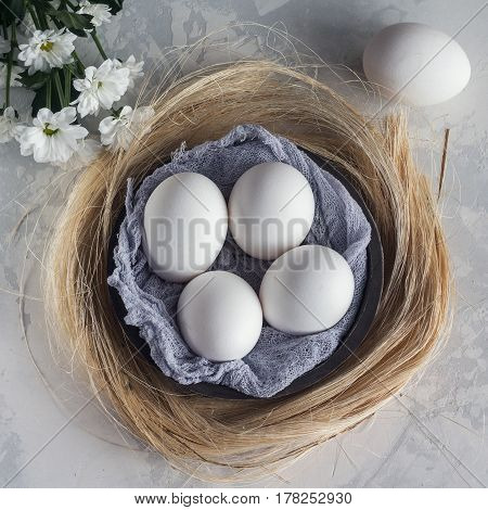 White Eggs In Wooden Bowl On White Background, Top View