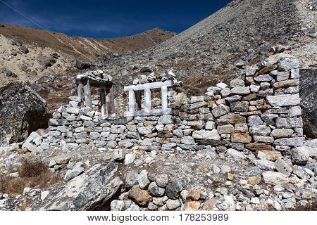 Handmade unfinished Stone Building made off natural peaces without using cement according to traditional manual work technology used in remote Mountain Villages of Nepal Country