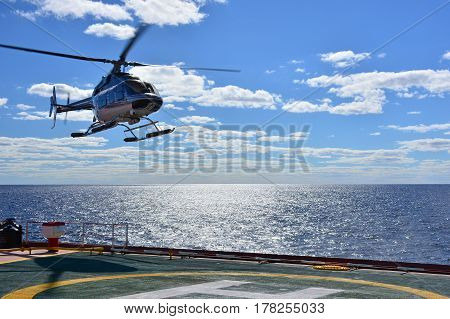 Ship-helicopter operation on board of large tanker at sea