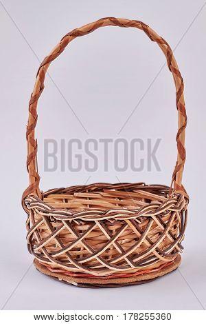 Easter wicker basket, white background. Side view of a basket. Online handicraft shop.
