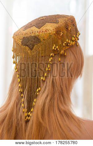 Pretty young woman in the Uzbek wedding skullcap