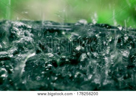 Flowing water rain abstract background in nature