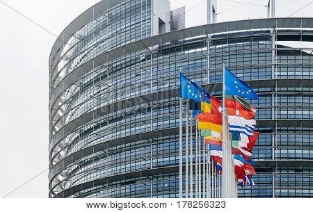 Official European Union flags - European Parliament building in Strasbourg France with flags waving
