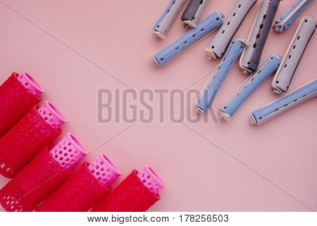 Different Curlers Isolated Over Pink. Top View