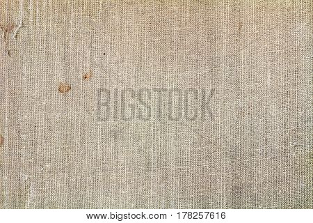 Old gray textile texture with stains and damage. Abstract background