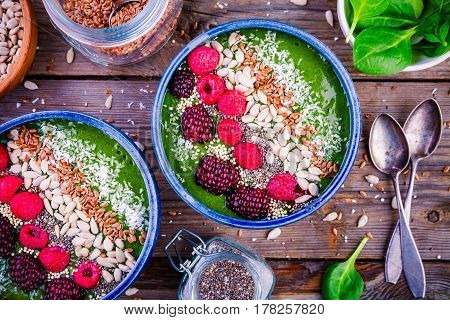 Green Spinach Smoothie Bowl With Raspberry,.blackberry,.flax Seeds, Sunflower Seeds And Coconut Chip