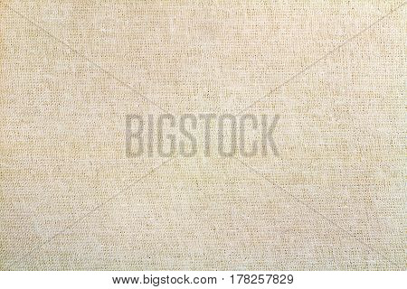 Vintage beige textile texture closeup. Abstract background