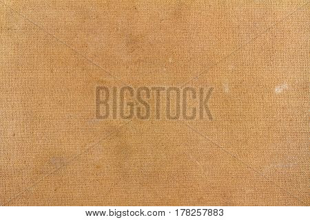 Vintage brown textile texture with spots. Abstract background