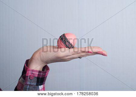 Female Hand Holding Easter Egg,