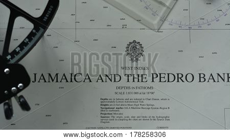 Navigation tools (pen, sextant, divider, parallel rule) on chart