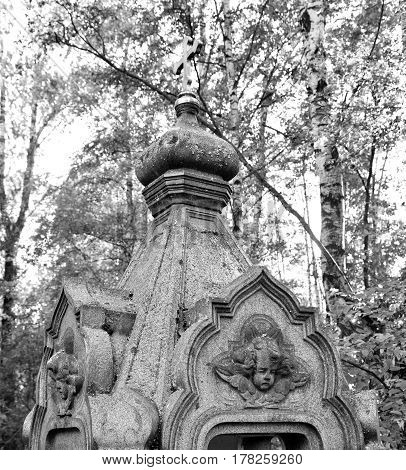 Fragment of the old necropolis in the cemetery. Black and white.