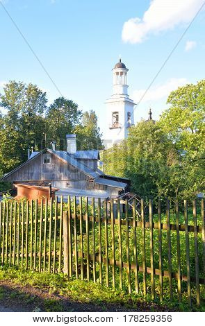 Rural landscape with the Orthodox Church of St. Alexander Nevsky in Ust-Izhora town St.Petersburg suburb Russia.