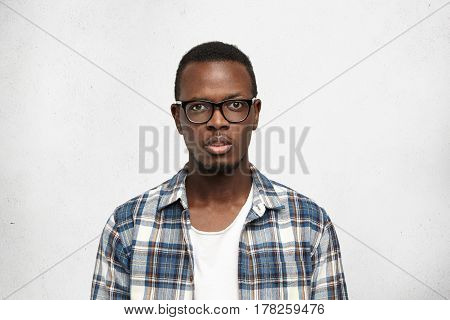 Young African American Man Student In Big Stylish Eyeglasses Standing Isolated On White Background A