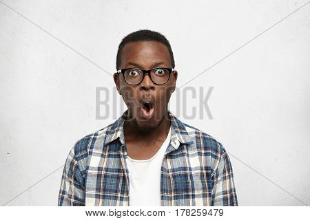 Strong Human Emotions And Facial Expressions. Close Up Portrait Of Absolutely Shocked Young Man Look