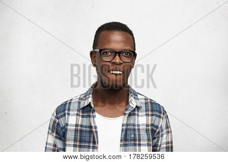Studio Shot Of African Student Having Fun Making Mouths, Showing Upper Teeth Like Rabbit, Looking Fu