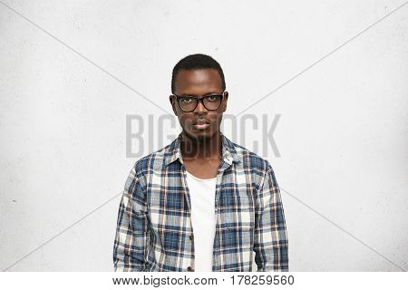 Closeup Portrait Of Handsome, Smart And Self-confident Young Black Male With Serious And Cool Face E