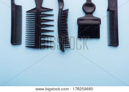 Hair Brushes On Blue Background With Copy Space