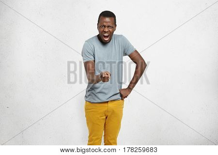 Look At You! Angry Young African-american Customer Pointing His Index Finger At Camera, Keeping Othe