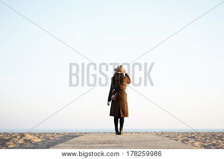 People, Nature And Leisure Concept. Unrecognizable Stylish Woman Wearing Stylish Hat And Long Black