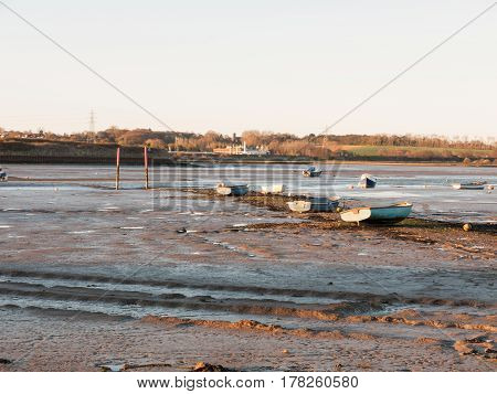 A wonderful shot of the river and its bank with the tide out on a clear day with boats
