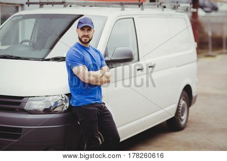 Man leaning against his van with arms crossed