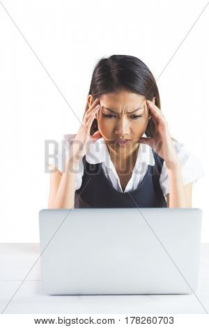 Nervous businesswoman using a laptop on white background