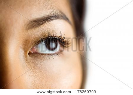 Close up view of a businesswoman looking away on white background