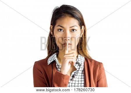 Serious businesswoman doing hush on white background