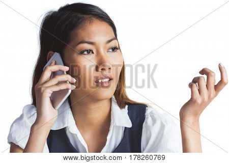 Businesswoman having a phone call on white background