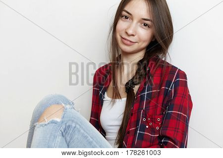 People And Lifestyle Concept. Portrait Of Charming Teenage Girl With Messy Hairstyle Dressed In Styl