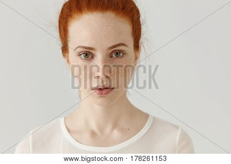 Close Up Shot Of Beautiful Young Redhead European Female With Extraordinary Appearance Relaxing Indo