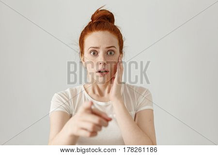 Portrait Of Scared Bug-eyed Young Redhead Female Having Fearful Terrified Expression, Frightened Wit