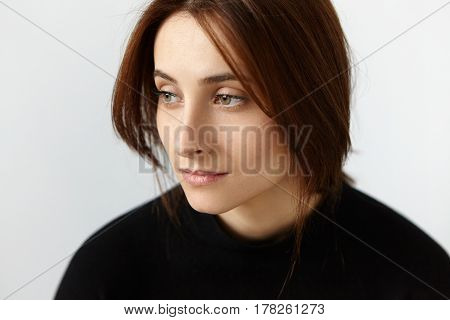 Close Up Portrait Of Thoughtful And Dreamy Girl Feeling Nostalgia, Having A Bit Sad And Lonely Look