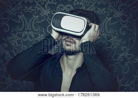 Young caucasian man in virtual reality headset enjoying simulation in cinematic style